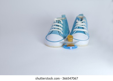 baby pacifier; shoe;