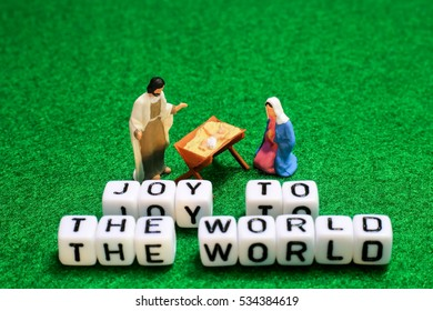 A baby with parent on grass background. conceptual image of the nativity of Jesus Christ for christmas celebration.