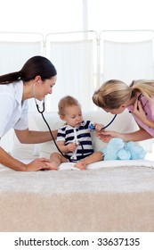 Baby with pediatrician and nurse in hospital