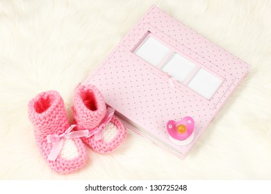 Baby photo album on white carpet
