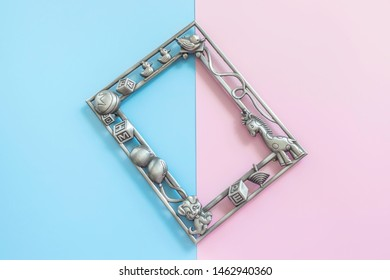 Baby photo frame on blue and pink background. Motherhood concept. Guessing unborn baby gender Girl or boy. Top view, layout, flat lay composition. Copy space for text.