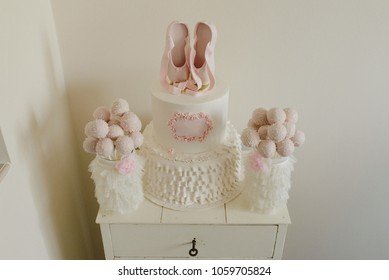 Baby pink ballerina cake with cakepops
