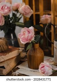 Baby pink rose flower in wooden vase. stilllife concept. selective focus