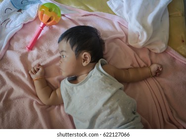 Baby play and sleep on bed