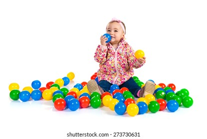 Baby playing with colored balls