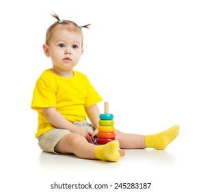 baby playing with colorful wood pyramid isolated