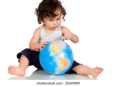 Baby playing with globe puzzle.