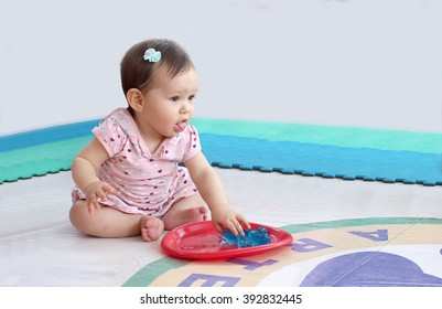 Baby playing with jelly to sensory stimulation