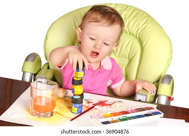 baby playing with a paints