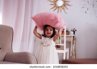 baby is playing with pillow