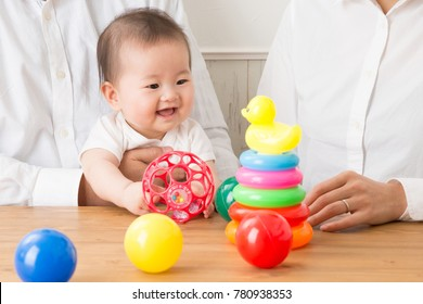 The baby is playing with some toys