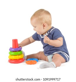 baby plays with colorful piramid
