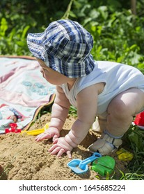 Baby plays with toys outdoors