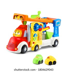 Baby Playset Toy Car Isolated on White Background. Side Front View of Modern Colorful Toddler Smart Wheels Big Rig Car Carrier. Set of Cars Toys. Birthday Gift. Electronic Semi-Truck Vehicle