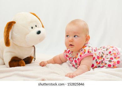 baby portrait with her dog toy