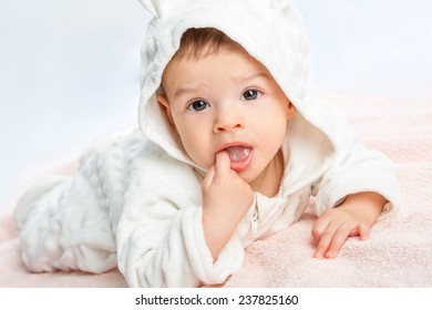 baby portrait with towel after bath. Charming baby. Beautiful baby under  blanket