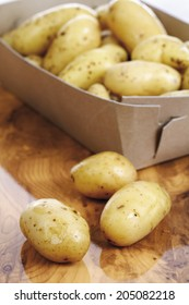 Baby potatoes in cardboard, close-up