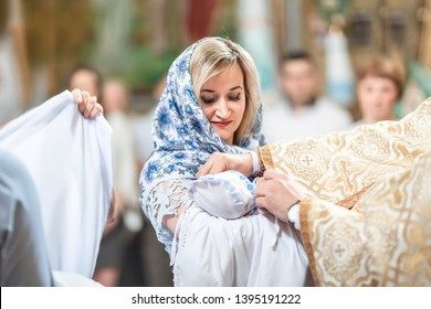 baby preparing for a baptismal ceremony, The sacrament of baptism. Attributes of an Orthodox priest for baptism. baptism Christening the baby.