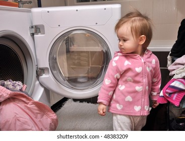 baby puts linen in washing machine