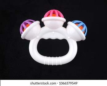 baby rattle on a black background