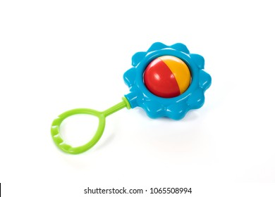 Baby rattle in the shape of a flower on a white background