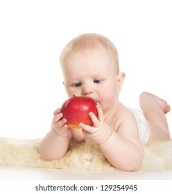 Baby with red apple, isolated on white