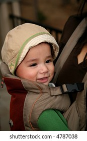 Baby riding in a front carrier