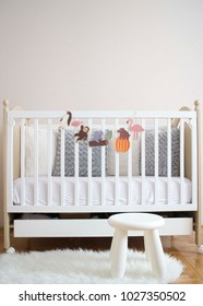 Baby room with bed and chair with place for copy space