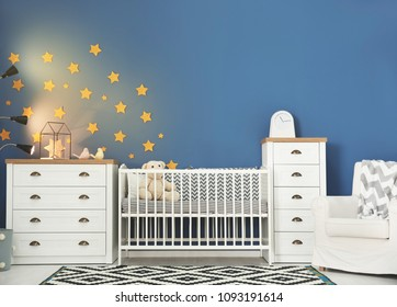 Baby room interior with comfortable crib and armchair
