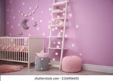 Baby room interior with crib near color wall