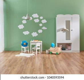 baby room modern and new style. Green wall and background decoration white detail and sofa. Modern cupboard decoration.