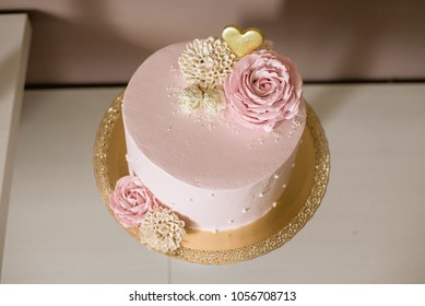 Baby rose cake and muffins arrangement