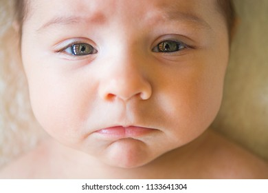 Baby with a sad face