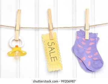 Baby Sale Goods on a Clothesline Socks Pacifier Dummy.