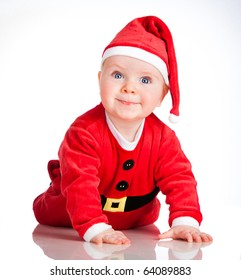 Baby In Santa Costume At Christmas on the white