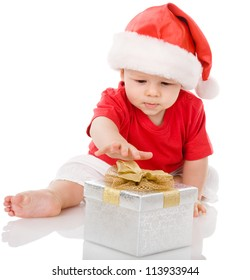 Baby in Santa hat playing with Christmas gift box. isolated on white background