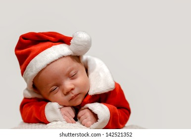 A baby in a Santa suit dreaming
