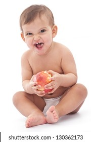 Baby with scared face keeping an apple. Isolated on a white backgeound.