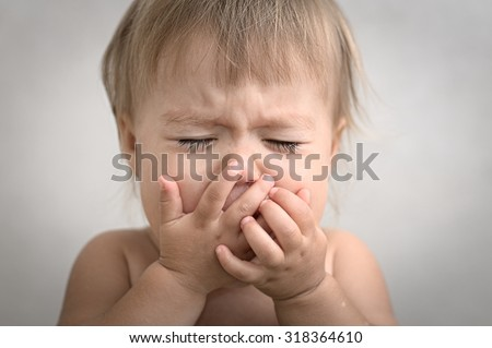 baby screaming crying portrait very emotional and dramatically