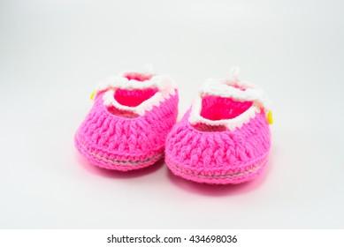 Baby shoe on white background