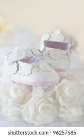 Baby shoes isolated against light background