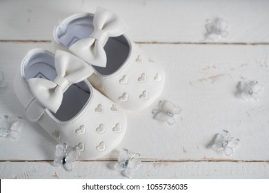 baby shoes on wooden table