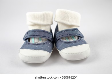 baby shoes and socks on white background