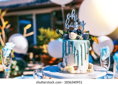 Baby shower blue cake on the decorated party table
