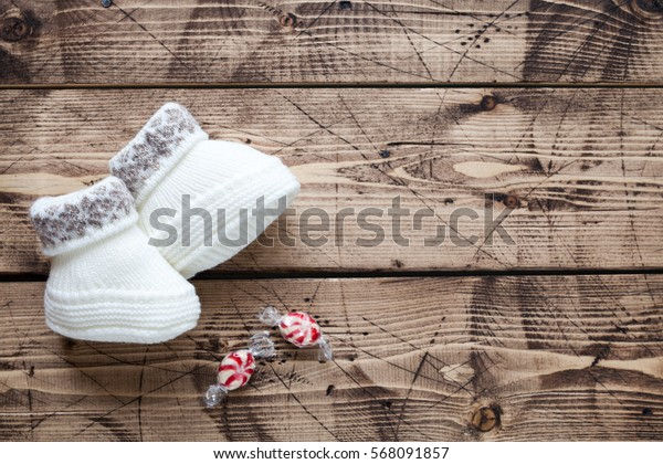 Baby shower concept on wood background - winter kid's clothes