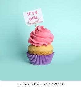 Baby shower cupcake for girl on light blue background