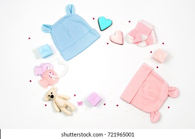 Baby shower party background with baby accessories on white background with blank space for text; top view, flat lay