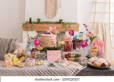 Baby shower party and cake, candies, marshmallows, cakepops, fruits and other sweets on dessert table