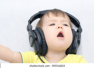 Baby singing song emotionally listening music with headphones