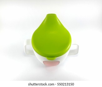 Baby sippy cup isolated on white background